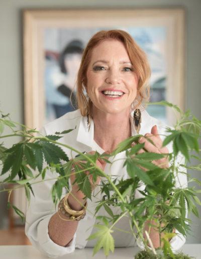 Holistic cannabis nurse with plant